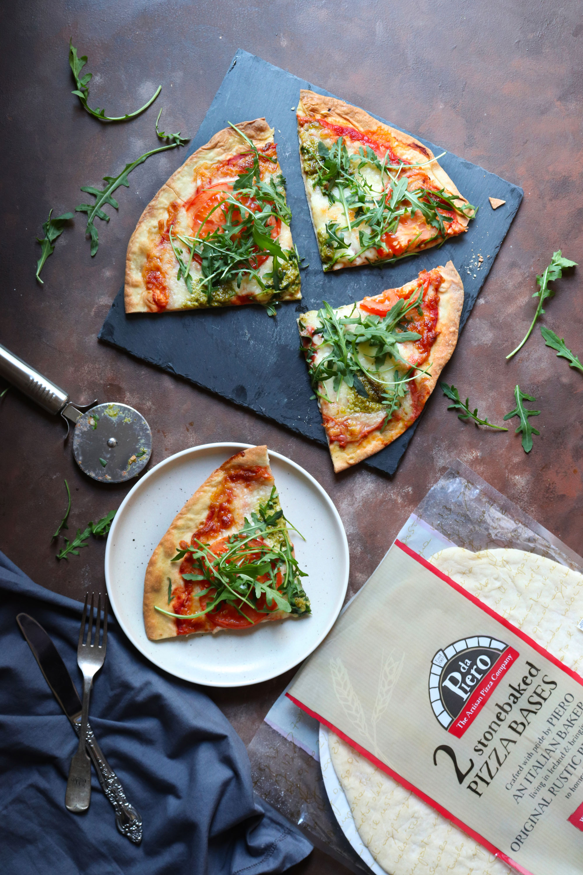 tomato mozzarella and basil pesto pizza